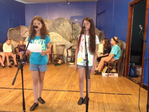 """Catherine and Claire rehearse a """"live commercial"""" for Natural Style Salon in Charlestown."""